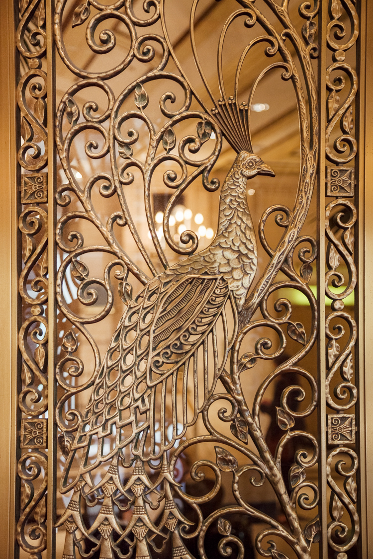 Don't miss the majestic Peacock doors designed and built by Louis Comfort Tiffany.