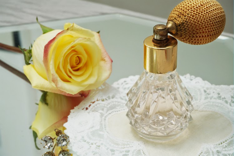 vintage perfume bottle and rose