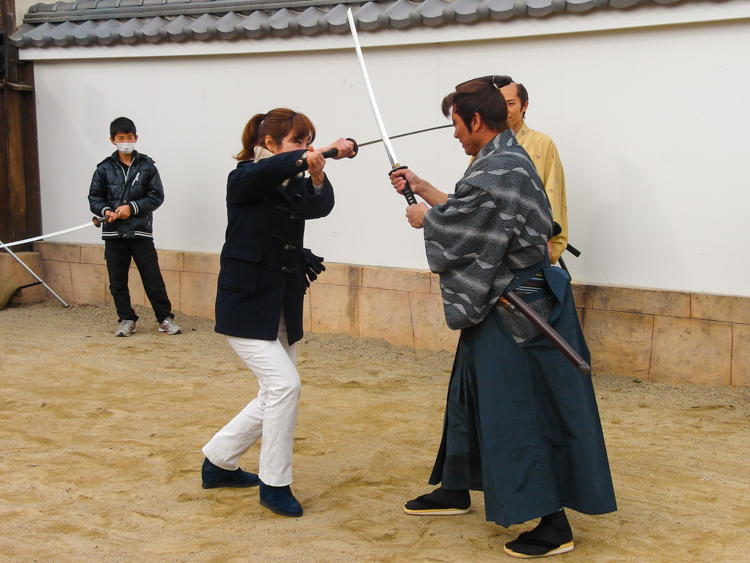 actor and woman swordfighting