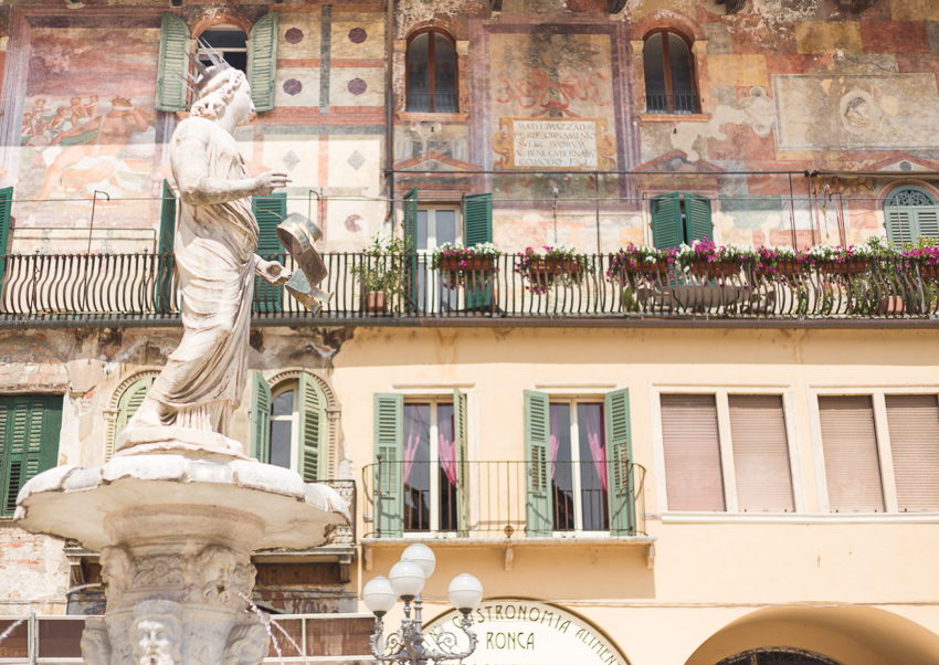 Old frescoes adorn the buildings of Piazza delle Erbe.